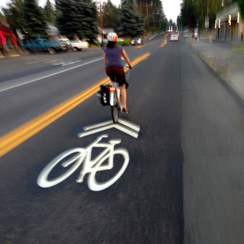 Sharrows keep riders centered in the road and clear of opened car doors.