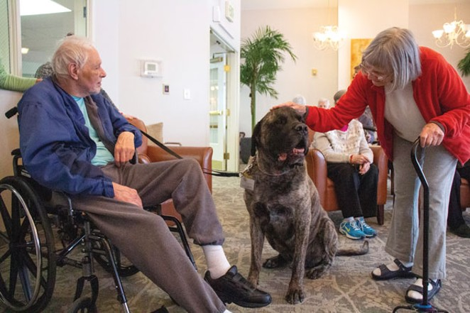 Jennifer Horsman and her therapy dog, Hobie, greet Apen Ridge Memory Care residents Done Gile and Anne Jackson. - KEELY DAMARA
