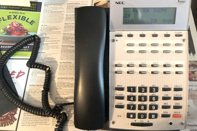 "For those not familiar, this is not a ""dumb"" phone, nor a ""smart"" phone, but a land line phone. It was used to call the businesses listed in the Restaurant Guide, ensuring their info is accurate. Of course, things change often, so when in doubt, call ahead. - NICOLE VULCAN"