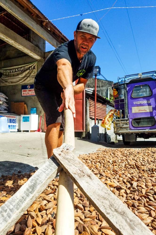 Jason Thomas works the pili nut harvest in the Philippines. - PILI HUNTERS
