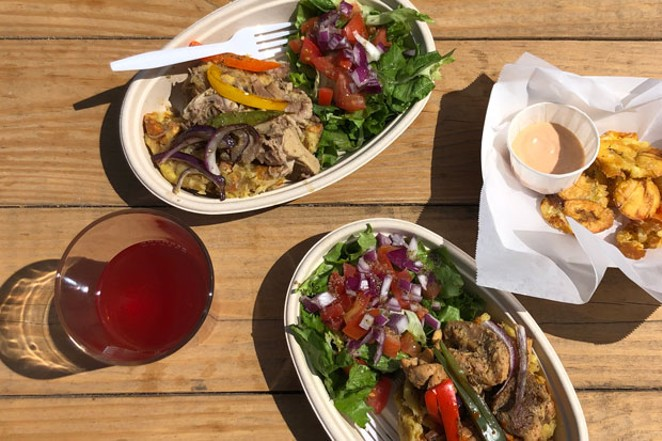 Taino serves up an assortment of Puerto Rican delicacies, including pork mofongo and tostones. - LISA SIPE