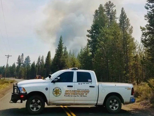A Deschutes County Sheriff's Office truck blocks a road near the Bridge Drive Fire in La Pine on May 8. - DESCHUTES COUNTY SHERIFF'S OFFICE