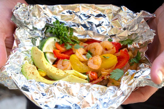 Fajitas can be prepped in foil packets and cooked on a grill for easy cleanup.  - KEELY DAMARA