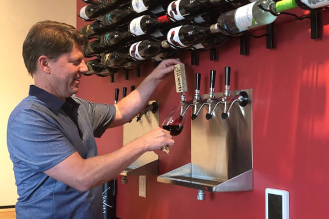 Kirk Ermisch draws a glass of wine at the new Elixir locacation on Arizona Ave. - LISA SIPE
