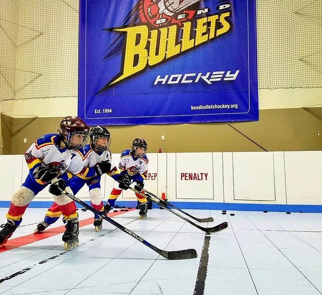 Members of the Bend Bullets hockey club work on drills at the Cascade Indoor Sports rink, which closed to skaters June 2. - COURTESY OF BEND BULLETS