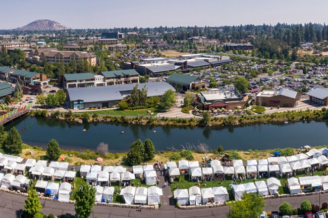 Artists from all over set up shop in tents along the Deschutes River in the Old Mill District for Art in the High Desert. - SUBMITTED