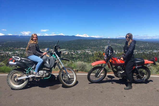Alyssa Shavlofsky atop the Big Bad Wolf and author K.M. Collins atop Little Red Riding Hood at Pilot Butte's summit. - K.M .COLLINS