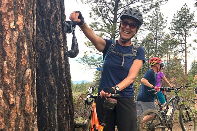 Bagged dog waste left for others to find is a common sight on the mountain bike trails in Bend. Local rider Ruth Williamson packed out this abandoned bag. - SUZANNE JOHNSON