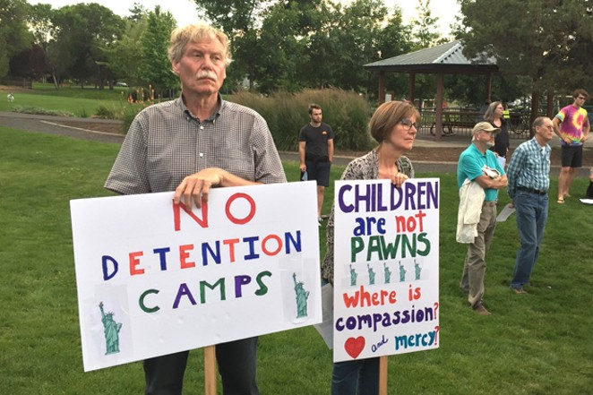 Bend residents take part in the recent Lights For Liberty: A Vigil to End Human Concentration Camps, held in Orchard Park. - GREGG HEACOCK