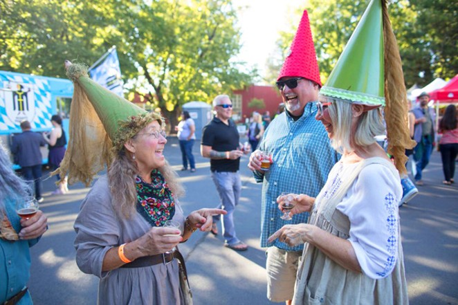 Revelers get into the spirit at the Little Woody. - BRIAN BECKER