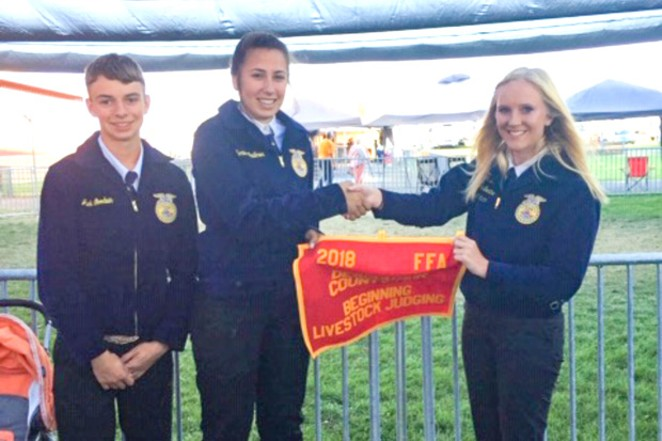 Sonna Faulkner, middle, presents the 2018 second place award for beginning livestock judging. - SUBMITTED