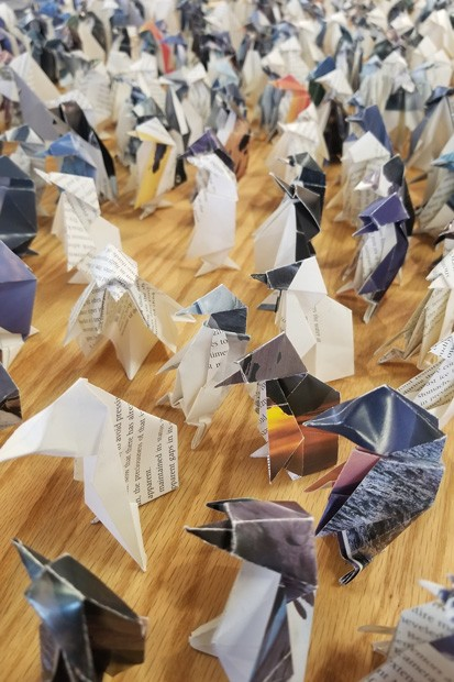"""Closeup of """"Flock,"""" an installation of 448 Origami Penguins by Susan Porteous. - CHRISTIAN BROWN"""