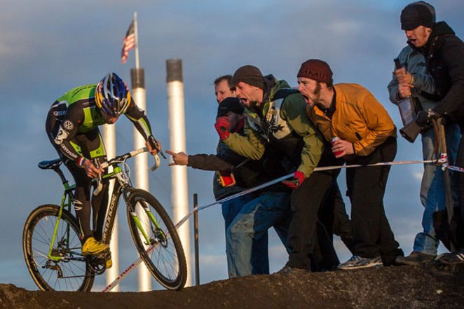 Tim Johnson jams during a 2012 cyclocross race in Bend and gets heckled by spectators. - MATTHEW LASALA
