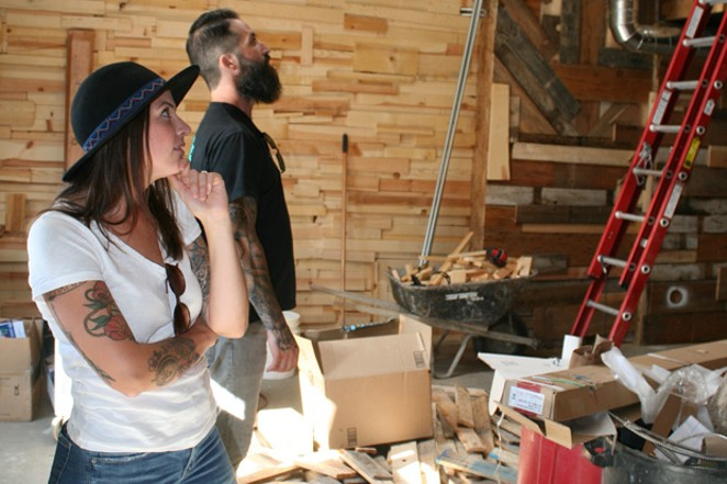 Owners Heather and Lisandro Ramon stand in the expanded portion of The Brown Owl, set to open in the next several weeks. - NICOLE VULCAN
