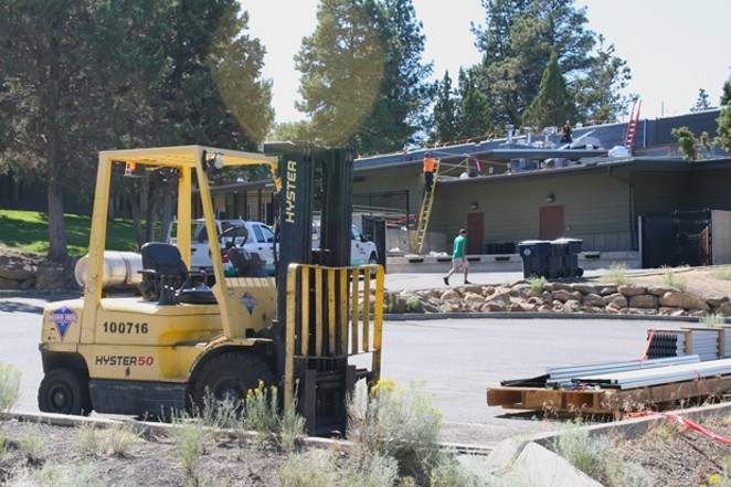 Crews work on the roof at Pilot Butte Middle School Aug. 27. - NICOLE VULCAN