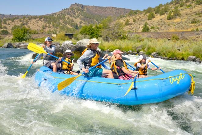 Nathan Wren guides a raft through Wapinitia, a Class 3 rapid on the Deschutes River, Aug. 5. - RYLAN BOGGS