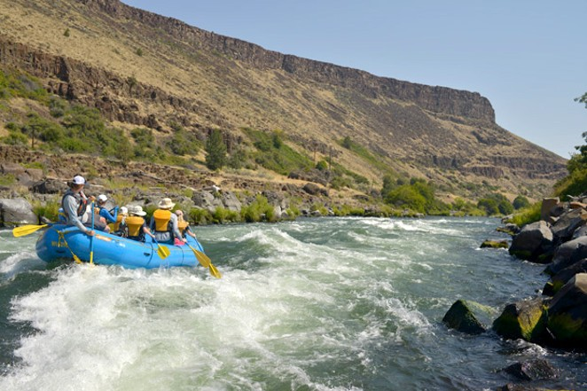 Nathan Wren guides a raft into Guide Launcher, a hole on the Deschutes River, Aug. 5 - RYLAN BOGGS