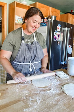 Annie Skelton rolls out pie crust dough, made with a recipe passed down from her aunt. - NANCY PATTERSON