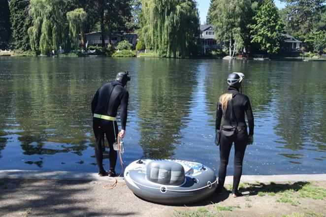 Kea Eubank & Miranda Campbell prepare to dive in the water at Pioneer Park. - ISAAC BIEHL