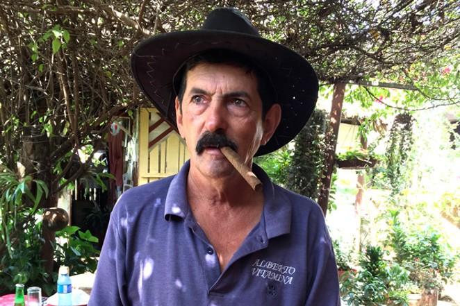 Alberto Vitamina shared more than just his roasted pig with his American visitor. - JOSHUA SAVAGE