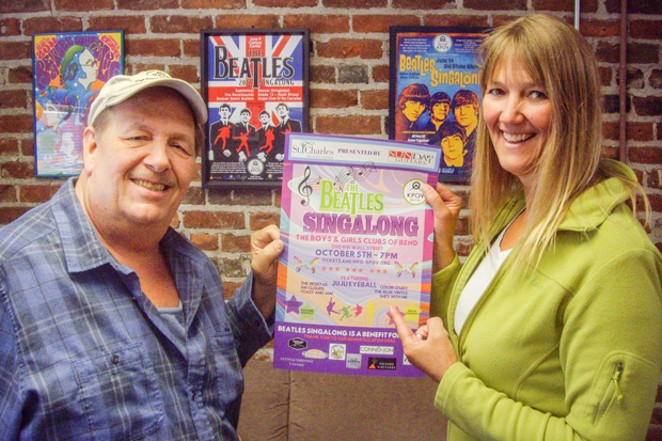 KPOV volunteers Rick Miller, left, and Lynn Bancroft hold up this year's Beatles Singalong poster in front of posters from past Singalongs. - RICHARD SITTS