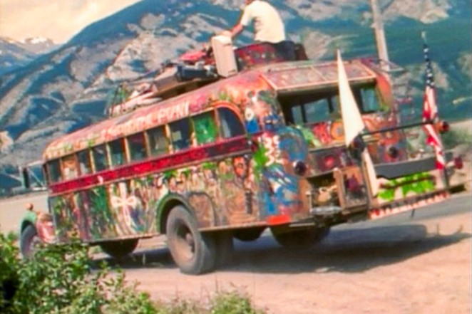 """Ken Kesey's original bus, """"Further,"""" rolling down the road to adventure. The Further bus that Kesey's son now drives is a later iteration of the bus. - RCARLBURG, WIKIMEDIA"""