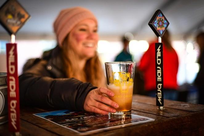 Ale Fest participants pour up samples for thirsty Bend locals. - COURTESY BEND ALE FESTIVAL