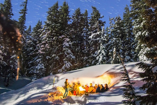Tour-goers take a break from snowshoeing to admire the vast beauty around them. - NATE WYETH