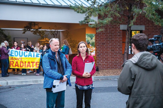 Paul Bacon and Elizabeth Hanley Szabo stand outside the Bend City Council chambers with a group of Elk Meadow Elementary parents who are protesting a planned Verizon cell phone tower near the school. - COURTESY STOP CELL TOWERS AT SCHOOLS