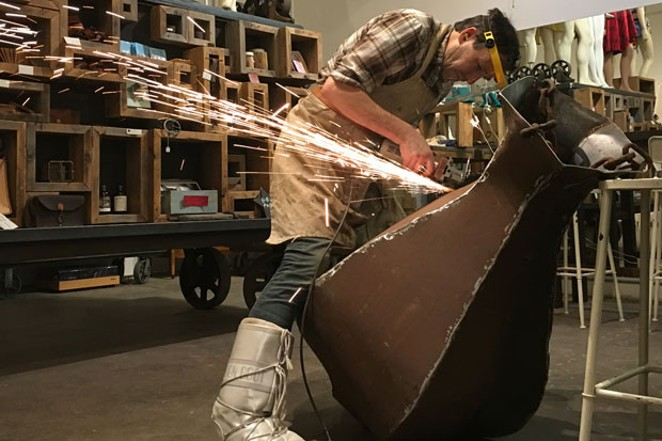 Breidenstein building a firepit for Winterfest 2018. - ABBY DUBIEF