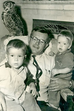 """The author and his """"feathered foster son,"""" Owl, and his other sons, Dean and Ross. - HARRIET ANDERSON"""
