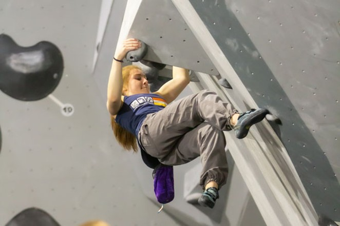 A young climber gets into her moves at Bend Rock Gym. - DIANA NAGAI