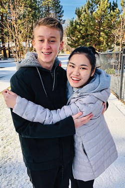 """Earn shares a hug with her """"brother"""" during her study abroad program in Bend. - COURTESY OF THE PRICE FAMILY"""