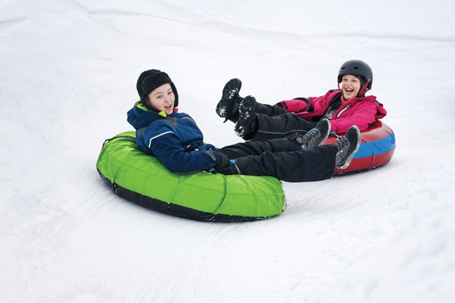 Family fun at the Snowblast Tubing Park. - ADOBE STOCK
