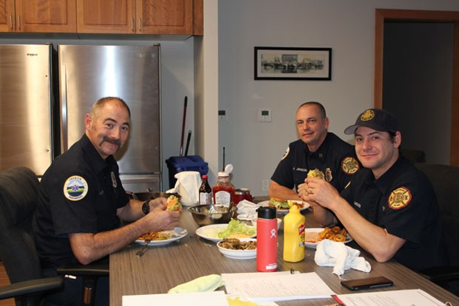From left, firefighter Alex McClaran, Capt. Jeff Jenson and engineer Kevin Dieker enjoy one of their first lunches inside the new Tumalo Fire Station that opened Dec. 3. - LAUREL BRAUNS