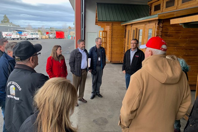 Rep. Cheri Helt, Erik Tobiason (Bend Heroes Foundation) and Bend City Councilor Bruce Abernethy take a tour of the 15 tiny homes for veterans stored at Mountain View Heating on Jan. 29. - COURTESY CHERI HELT