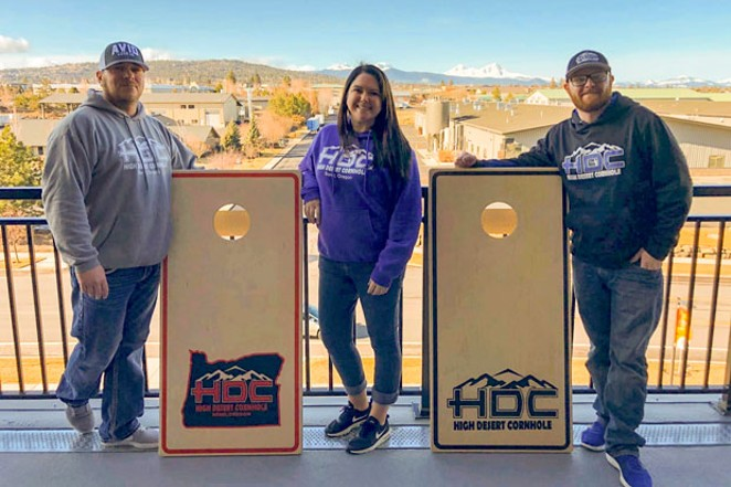 From left, Chris and Renee Yocum and Dustin Close are all high on cornhole. - BEN BAKER PRODUCTIONS