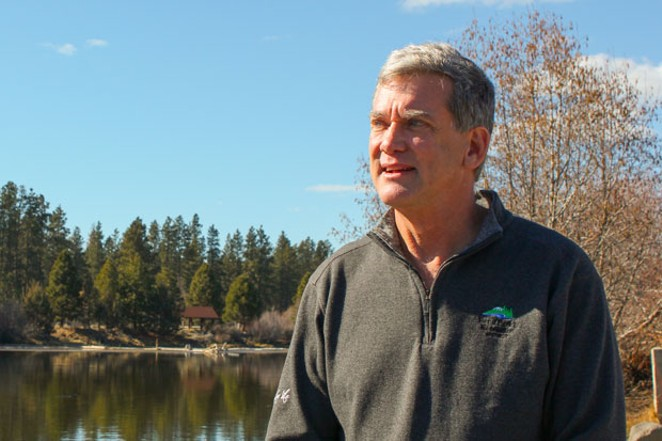 Bend Park and Recreation District Executive Director Don Horton stands on the banks of the Deschutes River near his office at Riverbend Park. - LAUREL BRAUNS