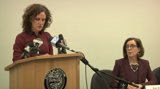 Dr. Jennifer Vines, tri-county health officer for Clackamas, Multnomah and Washington counties, with Gov. Kate Brown at Friday's press confence. - OHA