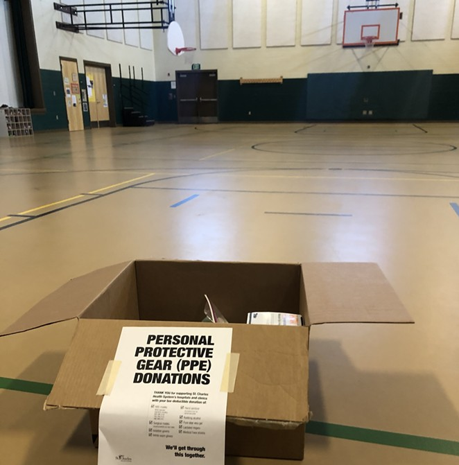 A box sits ready for donations Friday in the gym/cafeteria of Ensworth Elementary in Bend. Drop locations are located at grab-and-go lunch sites around Central Oregon. - NICOLE VULCAN