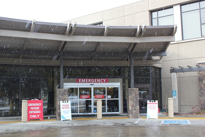 The entrance to the emergency department at St. Charles Medical Center in Bend on a snowy afternoon this winter. - FILE PHOTO - LAUREL BRAUNS