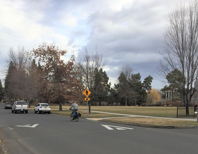 A cyclist rides past Harmon Park on NW Harmon Boulevard. - CITY OF BEND