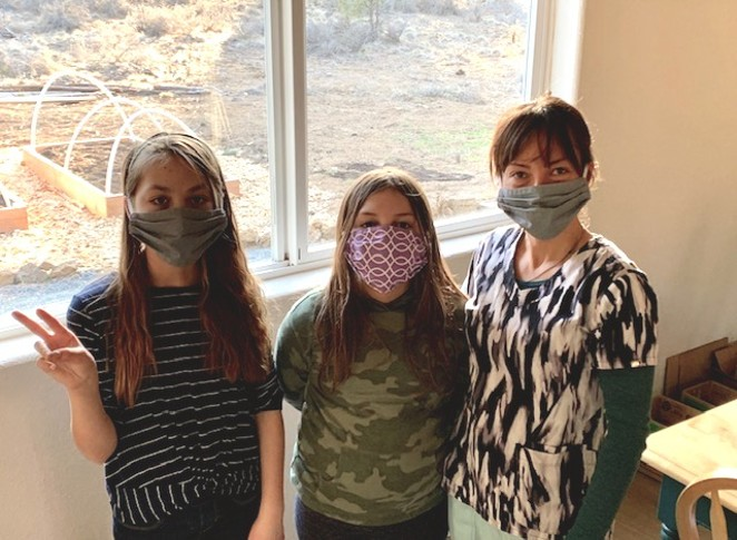 """The author's two daughters and wife, wearing the """"new normal"""" garb. - JOSHUA SAVAGE"""