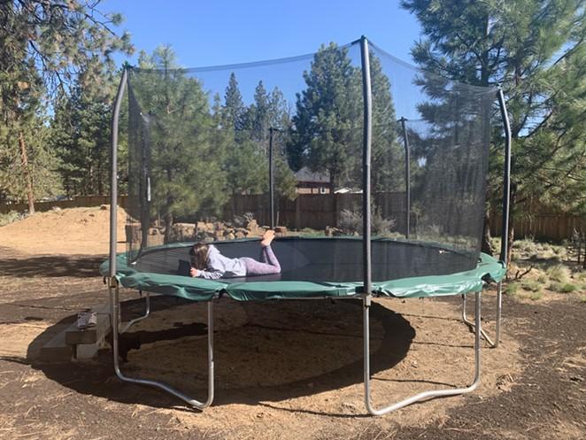 Social distanced learning on a giant, backyard trampoline. - JOSHUA SAVAGE
