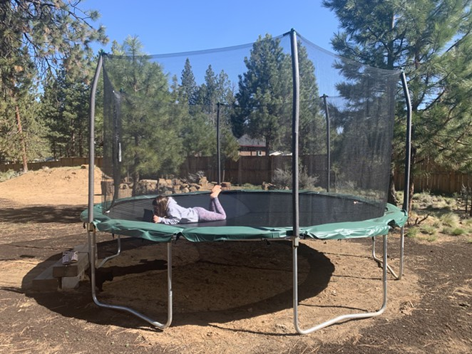 Social distanced learning on a giant, backyard trampoline. - JOSHUA SAVAGE