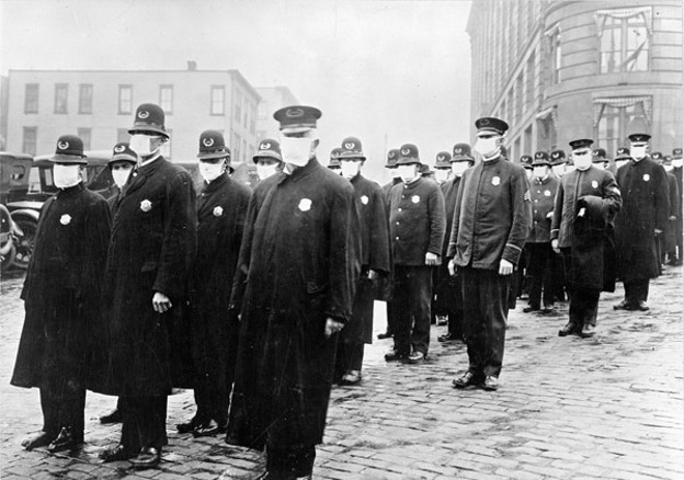The Seattle Police in 1918. Masks were mandatory in San Fransisco, but voluntary in Seattle, Washington and Portland. - CENTERS FOR DISEASE CONTROL AND PREVENTION