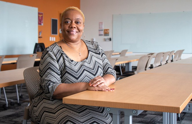 Erika McCalpine in a classroom at OSU-Cascades, during the Source's 2019 Woman of the Year photo shoot. - KEELY DAMARA