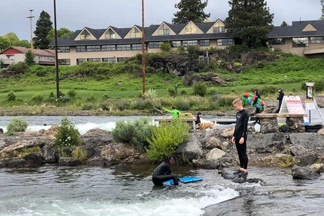Another day, another man-made wave at Bend's Whitewater Park—even in spite of cool temps. - NICOLE VULCAN