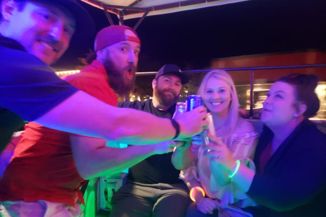 A group of happy strangers clinking White Claws to a night well spent. - CAYLA CLARK