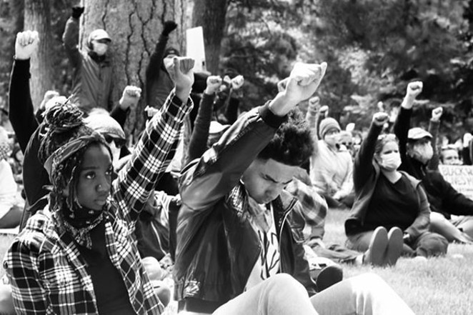 Protesters show their unity during a rally in Bend. - ANDREA MARIA VAZQUEZ FERNANDEZ
